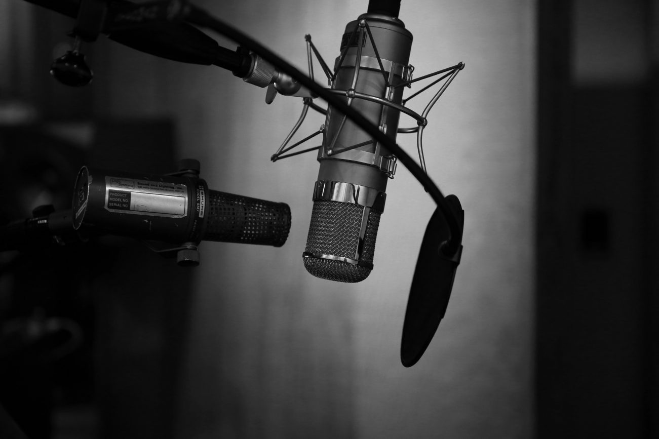 Recording media, black and white photograph of microphone with screen